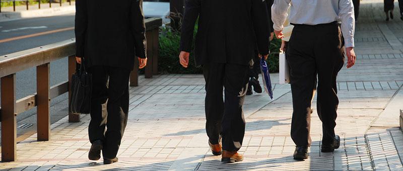 men walking from court