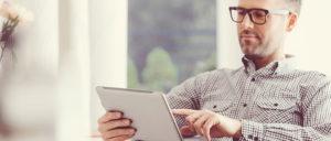 man watching webinar on tablet