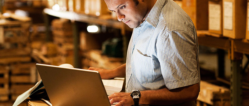 business owner looking at laptop