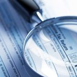 Magnifying glass on form 1040 tax return
